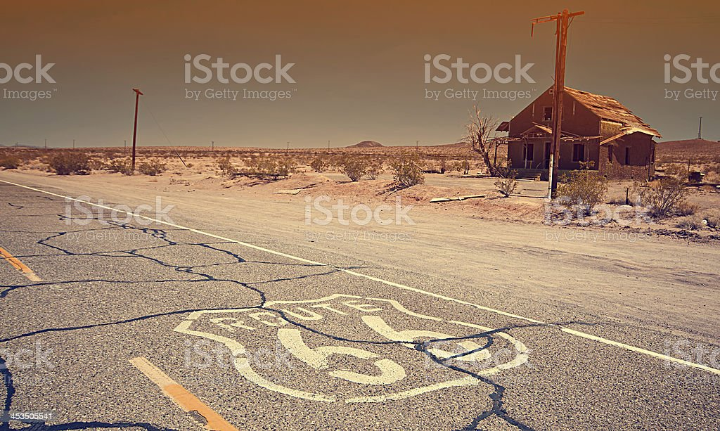 Route 66 that was painted on the road in the desert  stock photo