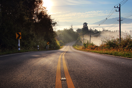 route and journey during sunrise with the mist