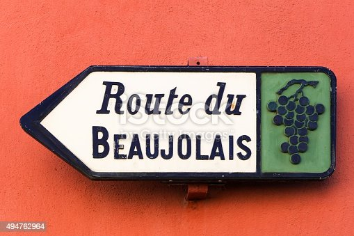 Road of Beaujolais sign on a wall, France
