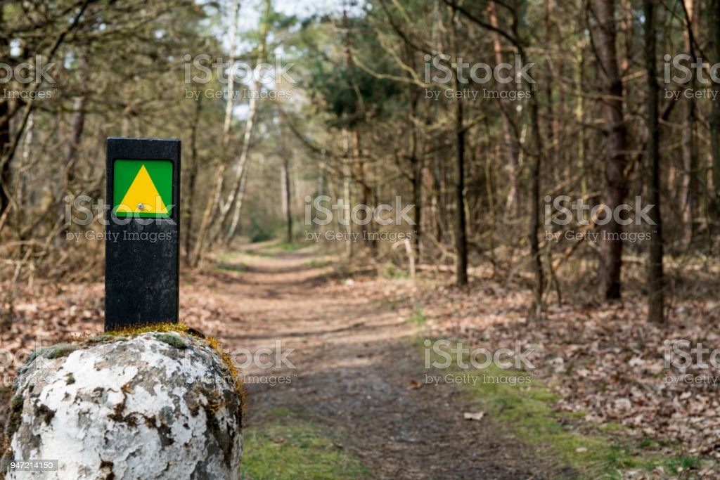route sign, hiking path with trees,  reserve De Malpie in Valkenswaard, The Netherlands stock photo