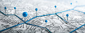 istock Routes with blue pins on a city map. 1287428960