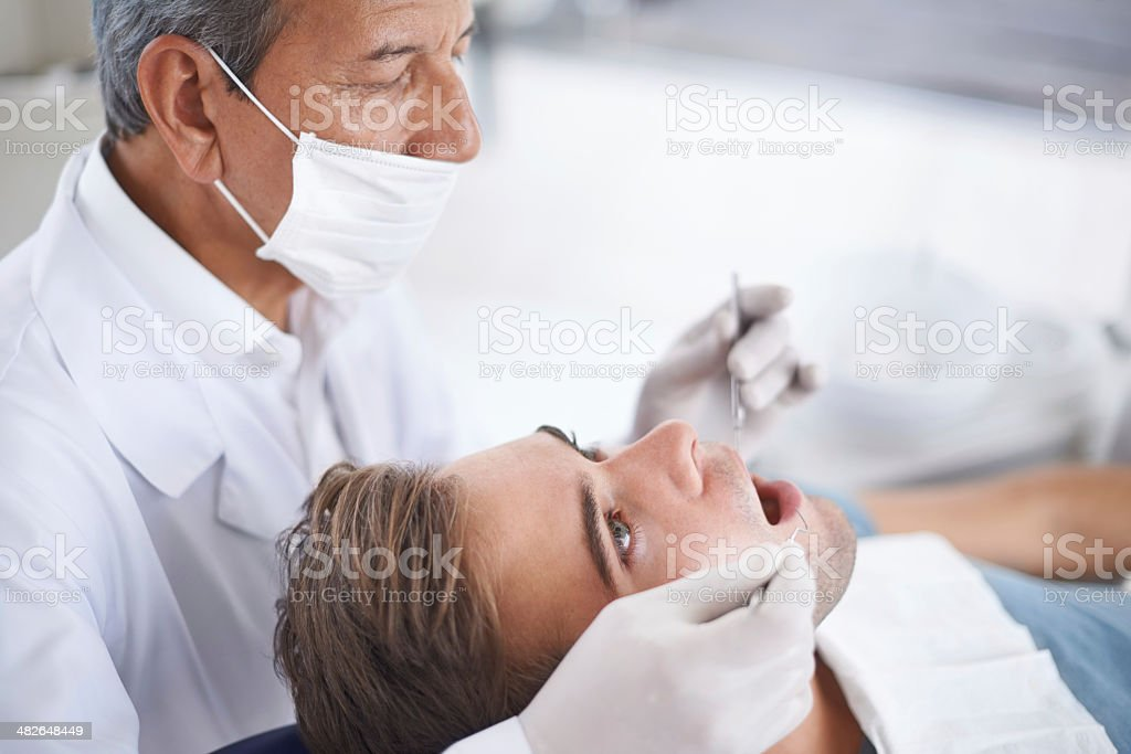 Routine check-up at the dentist royalty-free stock photo