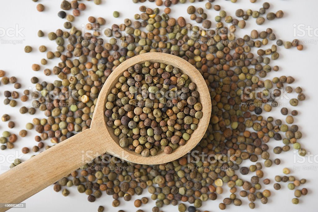 Roveja seeds in a wooden spoon royalty-free stock photo