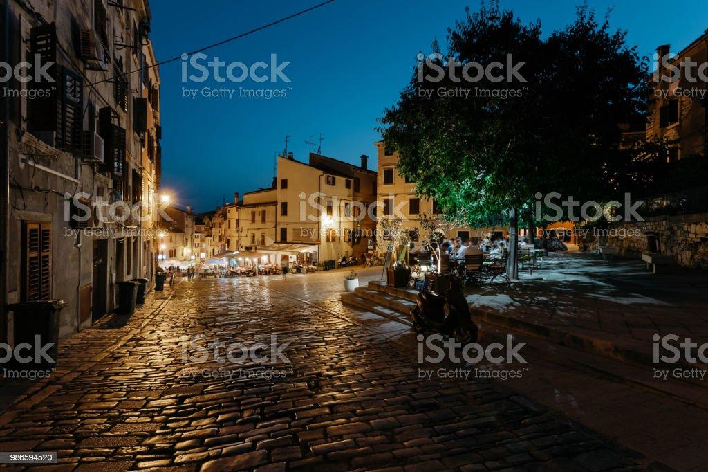 Rovinj, Croatia - July, 2016 - Night street with restaurants and...