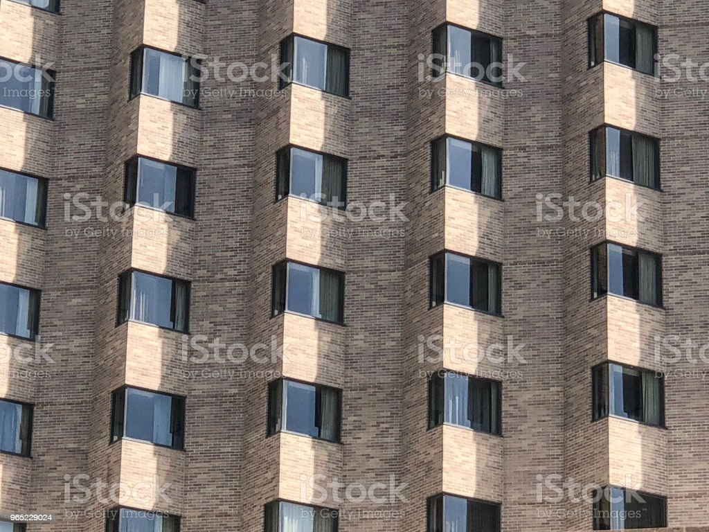 Row and columns of windows on brick building royalty-free stock photo