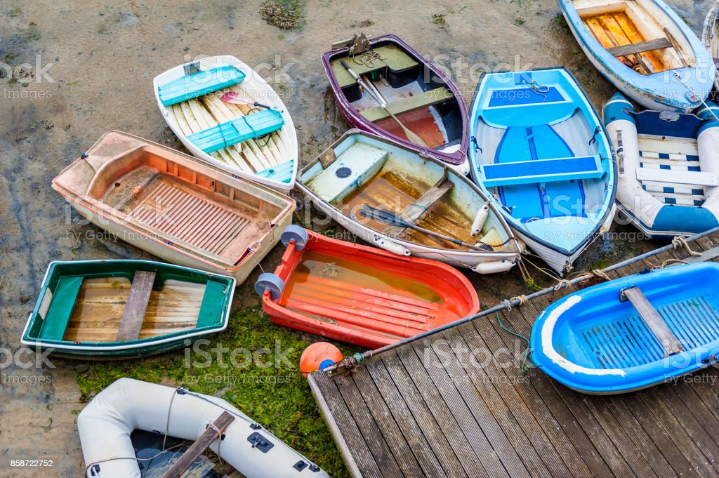 Row Boats at Low Tide in Harbour of Saint Aubin Jersey stock photo
