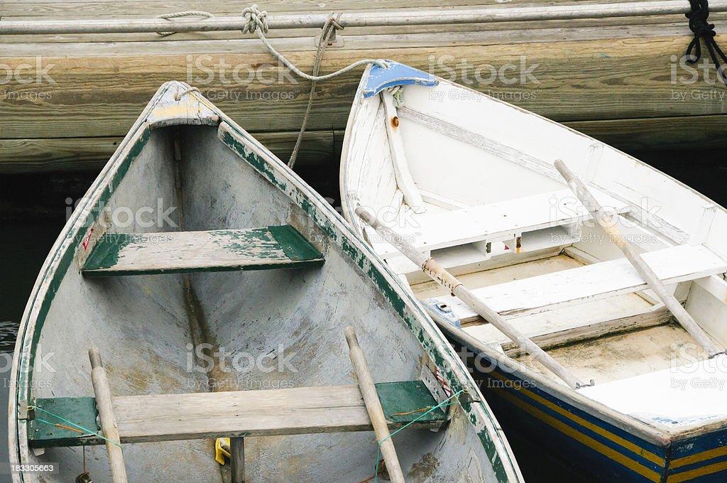 Row boats tied to a dock royalty-free stock photo