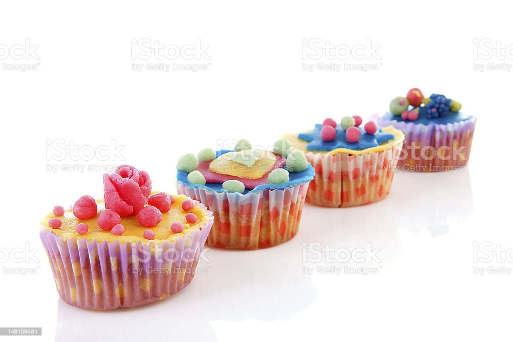 row cupcakes with marzipan decoration royalty-free stock photo