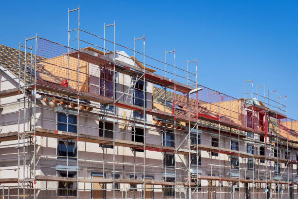 Row houses under construction  / New settlement Row of brandnew twin houses. scaffolding stock pictures, royalty-free photos & images