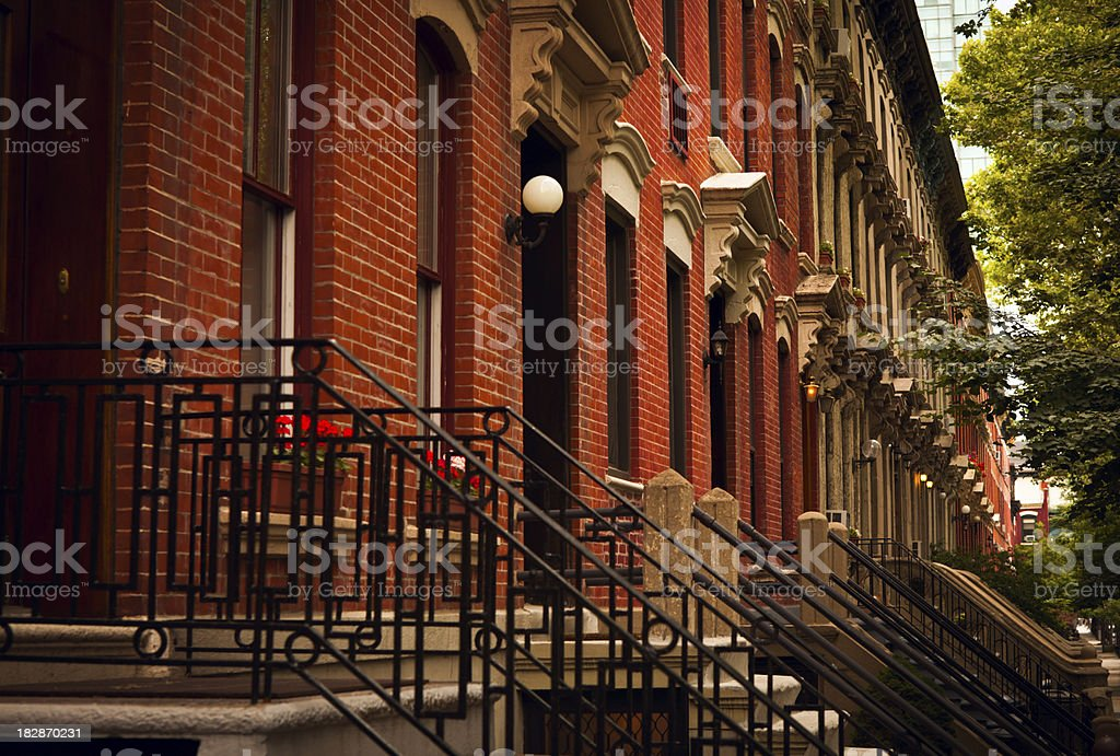 Row Of 19th Century Brownstone Homes on City Block royalty-free stock photo