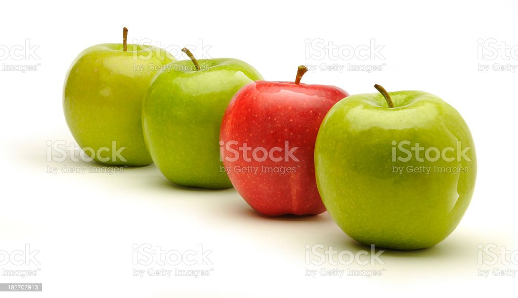 Row of 3 green apples and 1 red on white background royalty-free stock photo