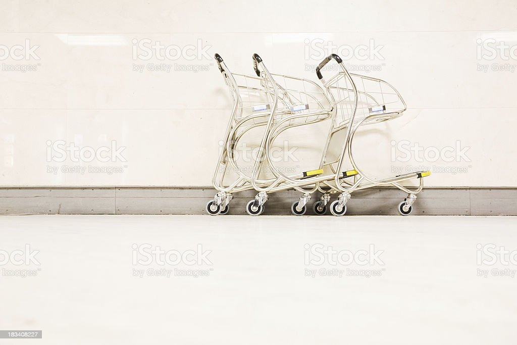 Row of airport luggage trollies _ horizontal royalty-free stock photo