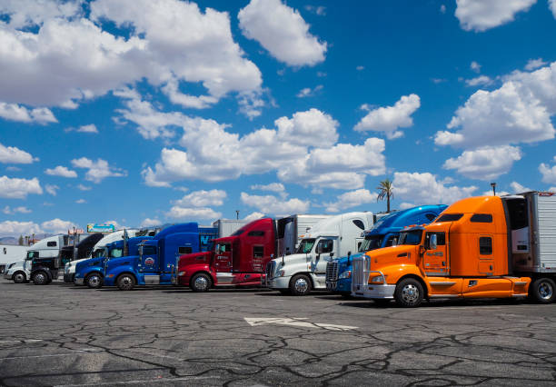 row of american trucks parked at truck stop - clark county nevada stock pictures, royalty-free photos & images