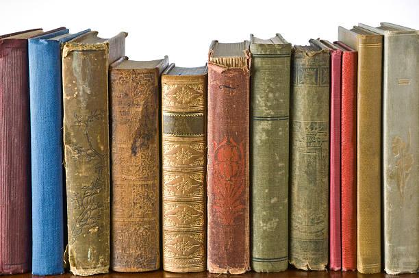 Row of antique books on a shelf stock photo
