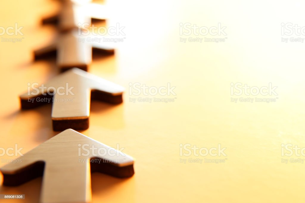 Row Of Arrow Pointing In The Same Direction Away From Camera stock photo