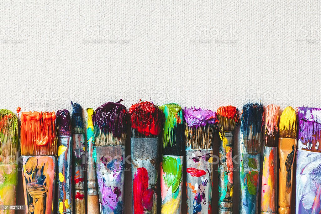 Row of artist paintbrushes closeup on canvas. stock photo