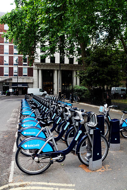 Row of Barclays Bikes in a London square stock photo