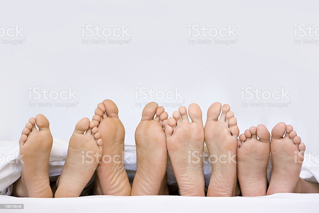 A row of bare feet stock photo