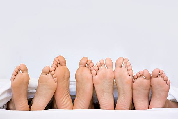 A row of bare feet  sole of foot stock pictures, royalty-free photos & images