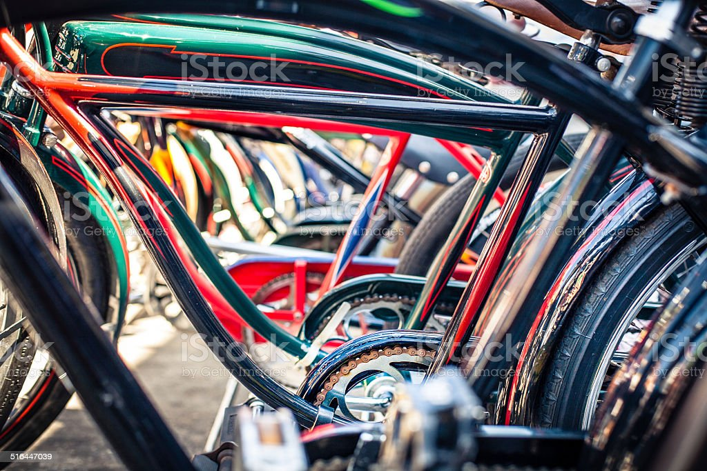 Row of Beach Cruiser Style Bicycles, Close Up Through Frames stock photo