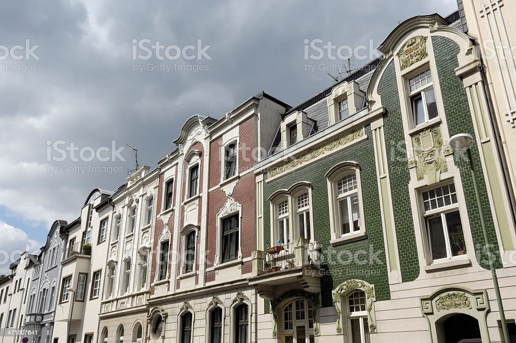 Row of beautiful townhouses art nouveau stock photo