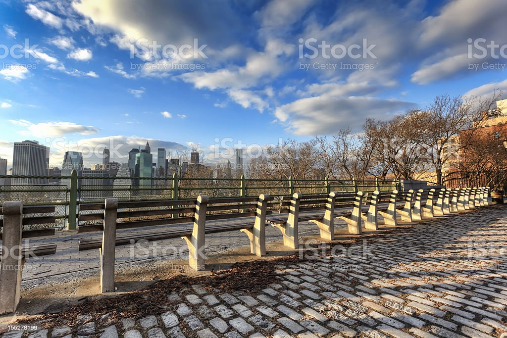 Row of benches facing Manhattan stock photo