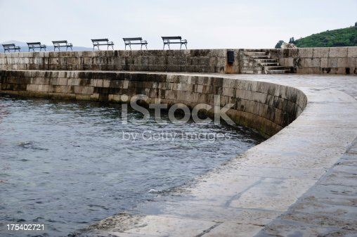 472923810 istock photo Row of benches on a sea wall 175402721