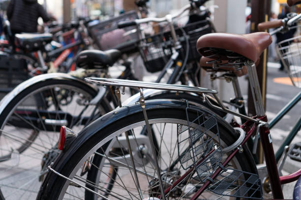 Row of bicycle Japan style classic with seats at sidewalk parking in Tokyo, Japan stock photo