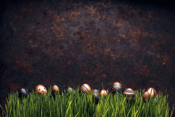 Row of black and golden Easter eggs stock photo