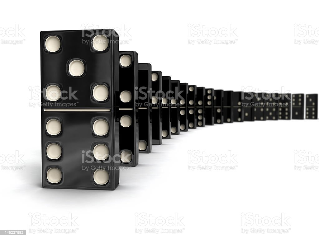 Row of black and white dominos lines up stock photo