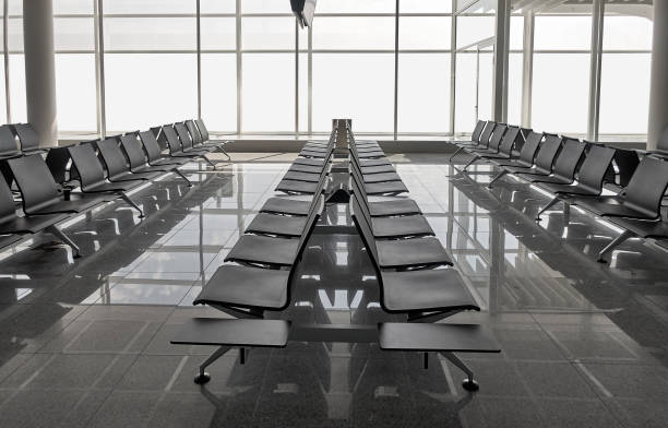 Row of black chairs at airport, shot in Europe - Munich stock photo