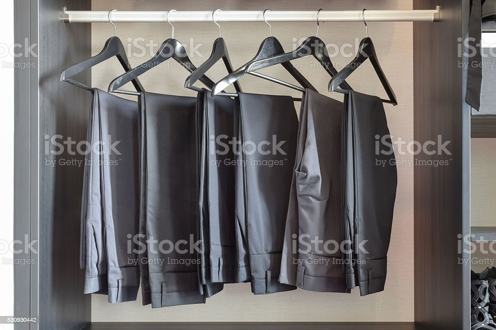 row of black pants hangs in wardrobe at home - Royalty-free Adult Stock Photo