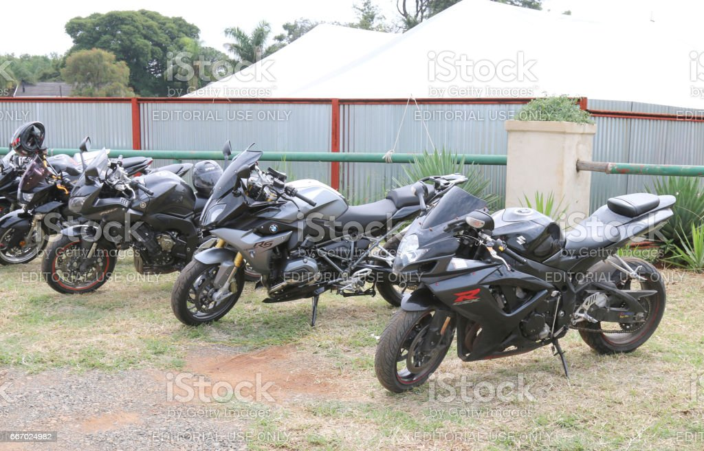 Row of black parked motorbikes at Yearly Mass Ride stock photo