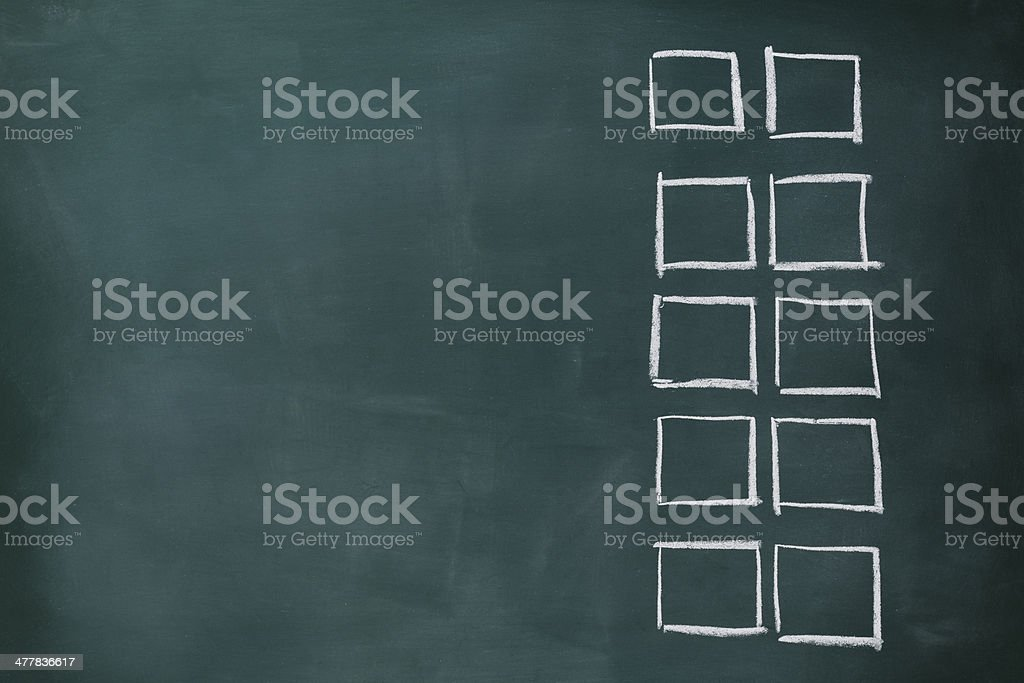 Row of blank check boxes on blackboard with copy space royalty-free stock photo