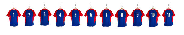 row of blue red football shirts 1-11 - sports uniform stock photos and pictures