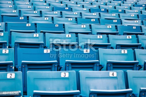 171581046istockphoto row of blue seats in a stadium 454153293