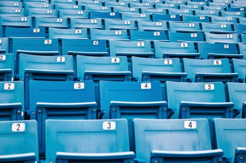 171581046 istock photo row of blue seats in a stadium 454153293