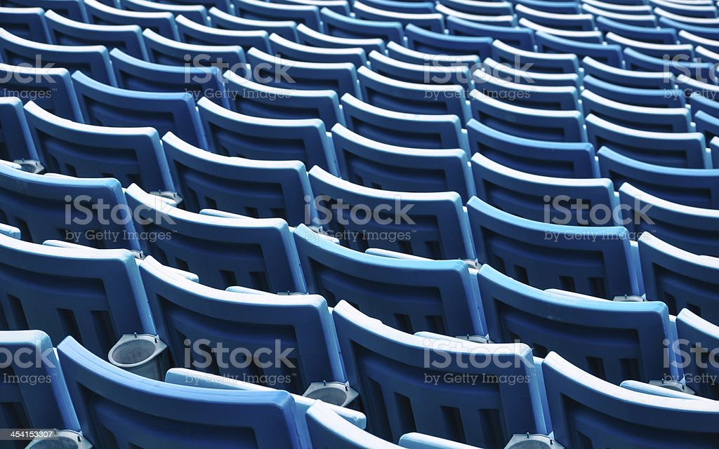 row of blue seats in a stadium royalty-free stock photo