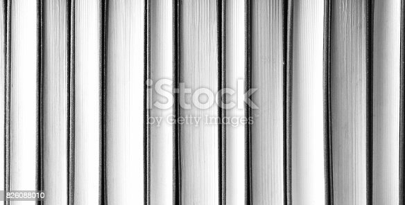 istock Row of books back and white 826088010