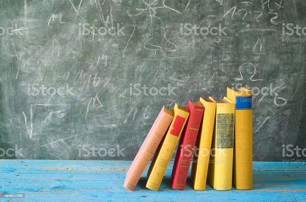 row of books, blackboard, education,concept stock photo