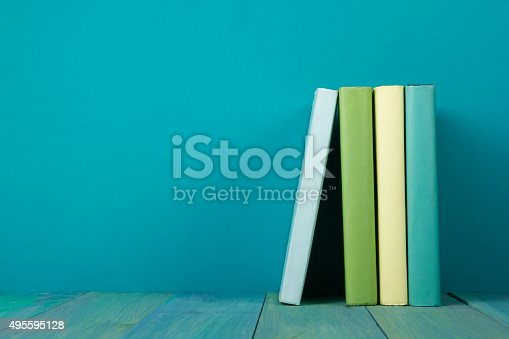 508711370 istock photo Row of books, grungy blue background, free copy space 495595128