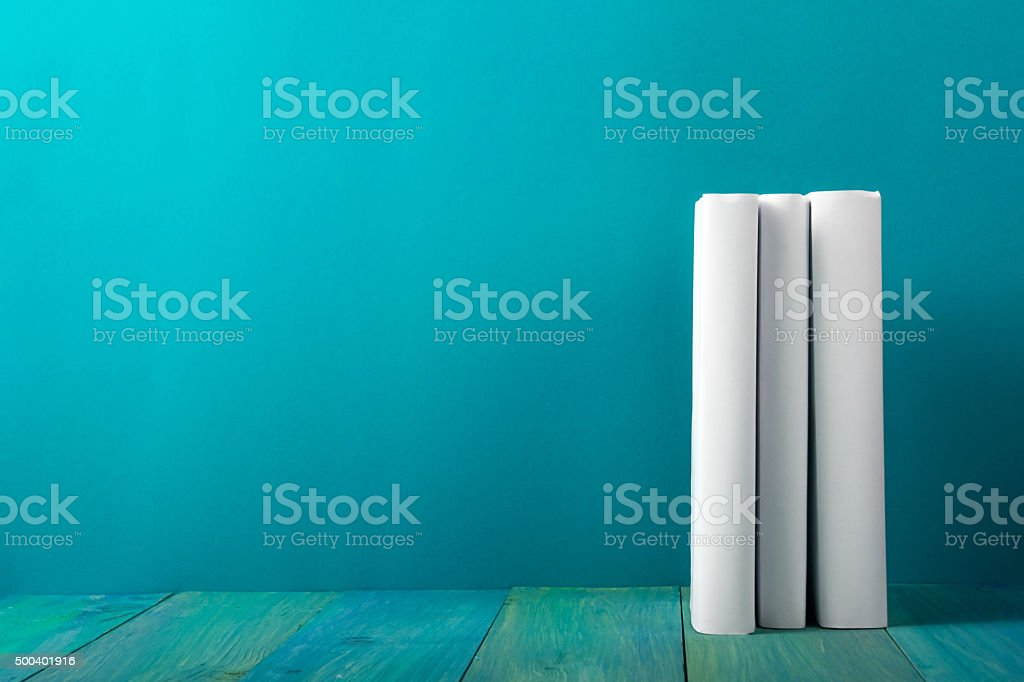 Row of books, grungy blue background, free copy space stock photo