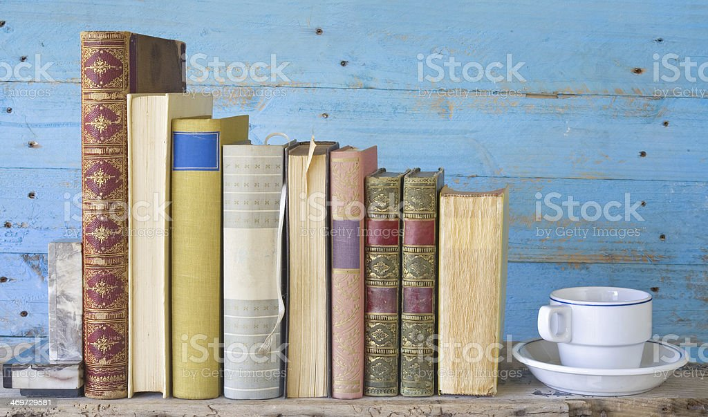 row of books with bookmarks and a coffee cup royalty-free stock photo