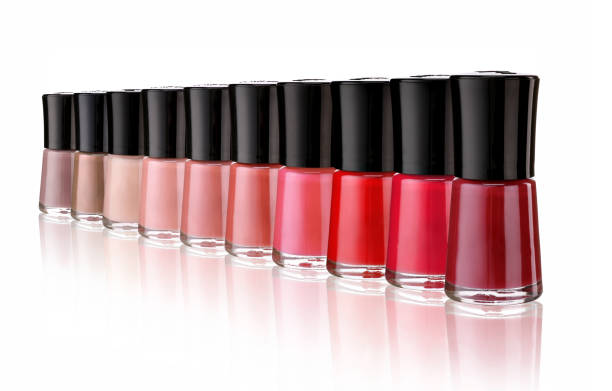 Row of bottles nail polish on white background. Row of bottles nail polish on white background. Close up. glossa stock pictures, royalty-free photos & images