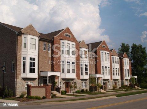 108220043 istock photo Row of Brick Condos With Bay Windows 98469898