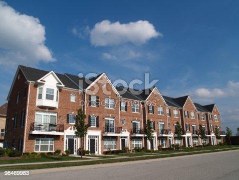 108220043 istock photo Row of Brick Condos With Bay Windows 98469983