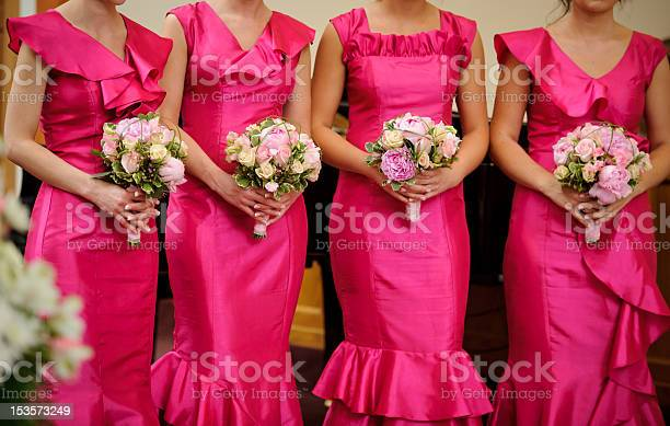 Row of bridesmaids with bouquets at wedding ceremony picture id153573249?b=1&k=6&m=153573249&s=612x612&h=gtwqsy1nfte6axgjkxrbkl9h0q393cj3niyll8zyt1i=