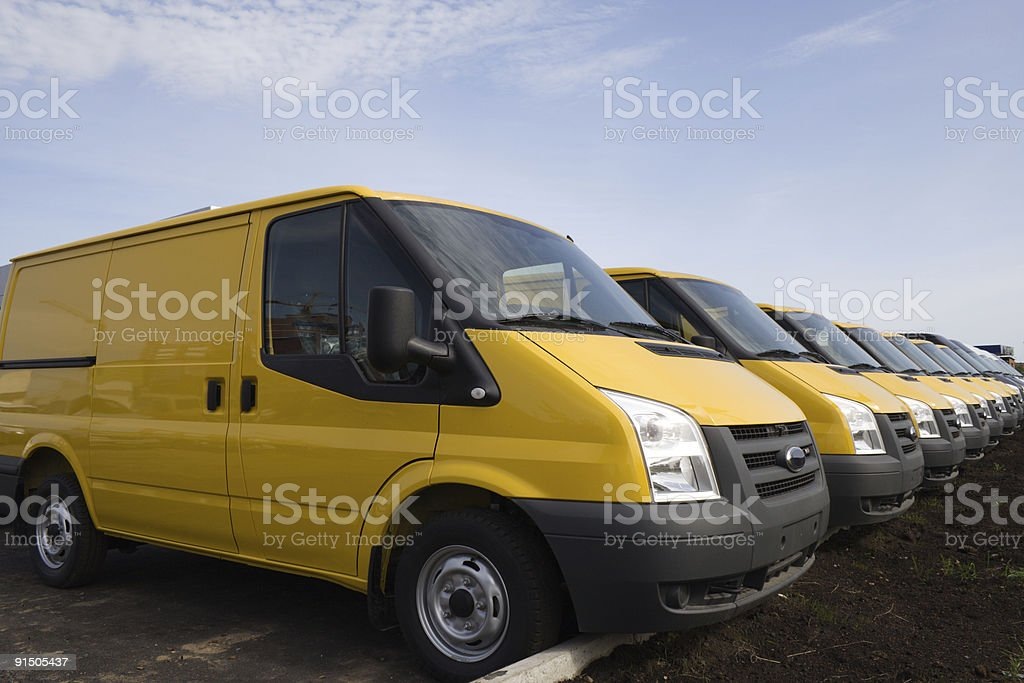 A row of bright yellow vans on a lovely day royalty-free stock photo