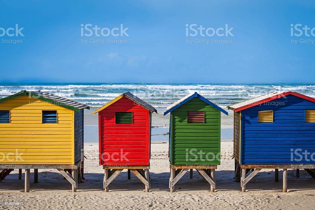 Row of brightly colored huts in Muizenberg beach. Muizenberg stock photo
