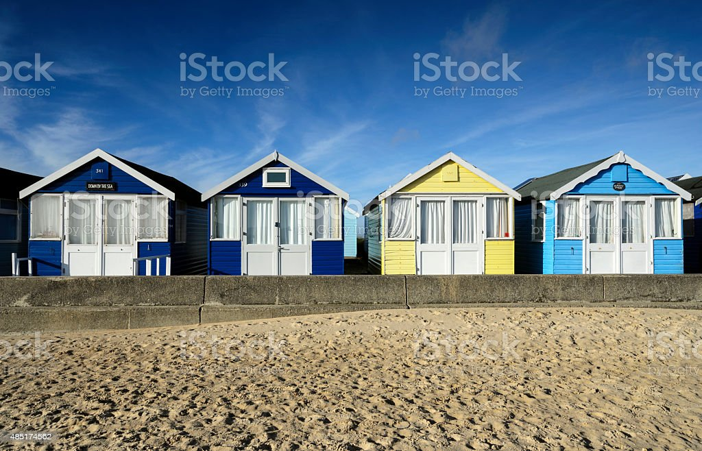 Row of brightly coloured beach huts stock photo